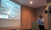 Dr. Richard Fuller presenting research results on migratory bird © Australia